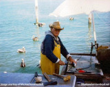 1982 - Walter Kandrashoff cleaning a mackeral at Miamarina