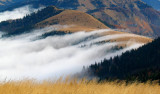 Morning mists rolling over mountain ridge