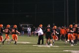 coaches welcome offense to the sideline after touchdown