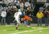 nick carries the ball toward the end zone