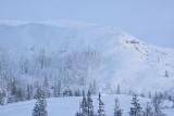 Sun over a snowy ridge
