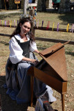 Lovely lass at the spinet