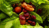 mixed organic greens with cherry tomatoes, walnuts and cranberries