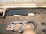 Hole in floorboard, bus Vientiane - Vang Vieng