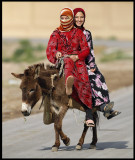 Girls riding a donky in Mheimideh