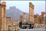 Early local bus passing the Palmyra ruins