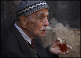 Old man having chai  in Damascus Old city