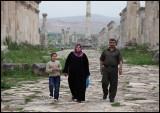 Family walking through the ruins of Aphamea