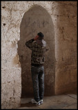 Young boy demonstrating a prayer song inside Krak des Chevalier