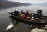 Fishermen on lake Kerini with pelicans waiting for food...