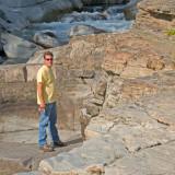 zP1060122 Man on rocks by MacDonald Creek in Glacier Naitonal Park.jpg