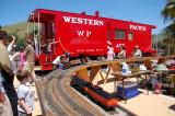 Big model trains and an even bigger caboose.