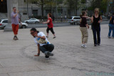 When the music gets funky, some bystanders start to break-dance