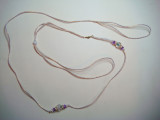 Lead 17-Gold and white cord with glass bead and purple accents