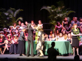Family gives the lei with the pin