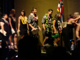 Students proceed off the stage