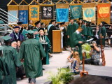 Clint coming up to Stage to Get Diploma