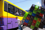 Colorful Plastic Milk Crates and Bus
