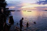 Young men diving at dusk