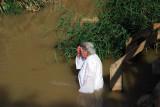 Old lady baptizes herself.