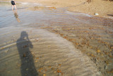 Salt deposits forming under water.