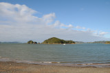 View of one of the hundreds of islands in the Bay of Islands from Paihia sea front