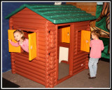 Noelle and Kylie in the log cabin
