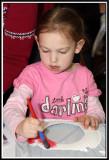 Noelle paints her fish bowl