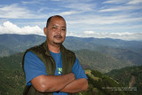 This was taken at the viewing deck of the highest point marker at Atok, Benguet. I set the exposure values of the 350D + Sigma 10-20  by metering off the brightest part of the sky, popped up the on-board flash, dialled in some FEC, then asked my brother Jeff to snap a pic....:)