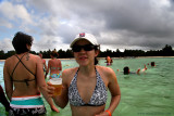 Jill drinking a beer in the Natural Pool complaining she's freezing in 80 degree water