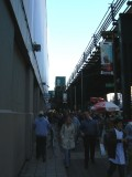 Fans walking by the ell toward the stadium entrances