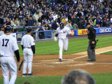 Robinson Cano touches the plate after hitting a home run