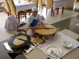 Preparing bazlama (Turkish flat bread) for hotel guests