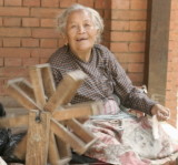 Old woman spinning in the back alleys of Bhaktapur