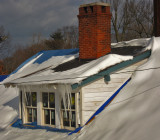 Closeup of the long icicles hanging from the dormer roof