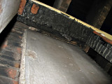 The ceiling beam and joist are burnt above the stove location.7823.