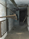 Prison-type wall bunks in Plotting-Spotting-Radion (PSR) room. Note suspension chain and S-hook on upper bunk.