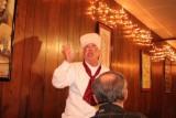 A very animated Leonard briefs the crowd on the upcoming cruise.
