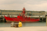 Contemplating the old red boat.jpg