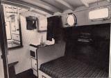 vanity, sink, & settee to port in salon