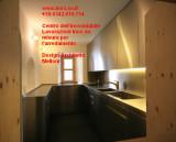 Cucina arredo su misura in acciaio inox top ante cassetti architetto Melloni St. Moritz