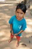 Cambodia. A serious black-eyed girl