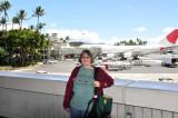 Judy poses at the airport