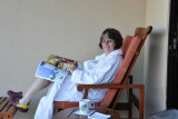 Judy enjoys a morning cup of Kona coffee