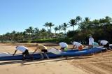 Pushing the canoe asea