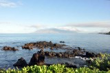 A volcanic reef points to West Maui
