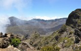 Clouds whip in and out of the crater