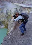 W Photographing at Edge of Caldera