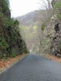 The rail trail cuts through the rocks