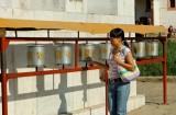 A woman turns prayer wheels at Gandan Monestary